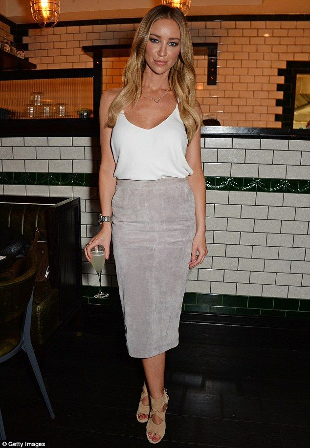 Stylish star: Lauren Pope was a vision as she attended the launch of Natasha Corrett's new...