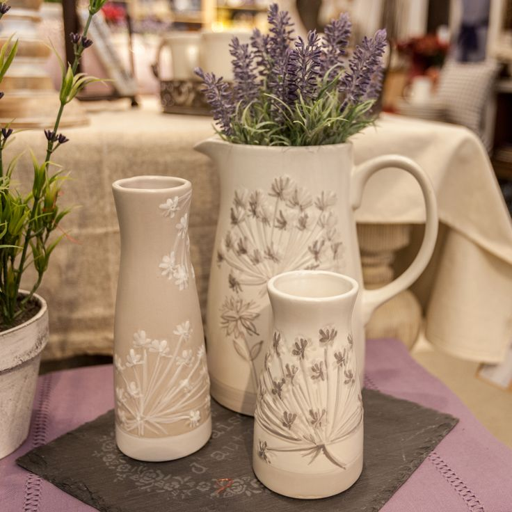 Beautiful lavender bouquets in rustic-chic vases will give a lilac breeze to your home!