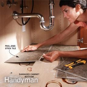 Use adhesive tiles under the sink to create an easy-to-wipe surface.