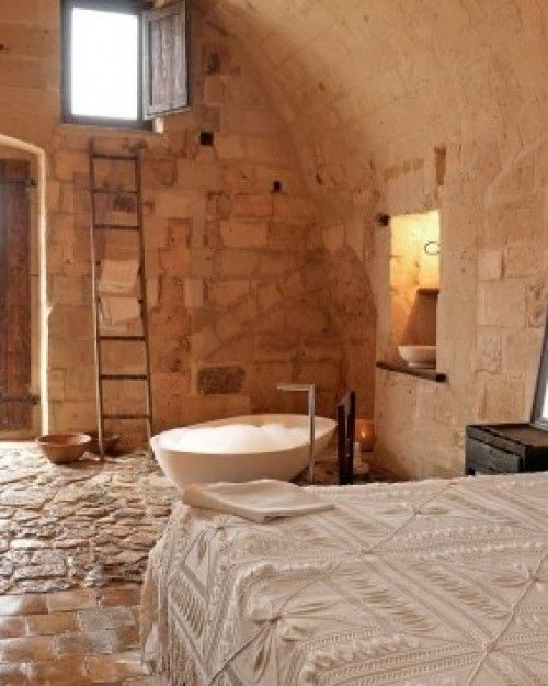 Stay in a romantic candlelit room from $129/night at the Sextantio Le Grotte in Matera, #Italy.