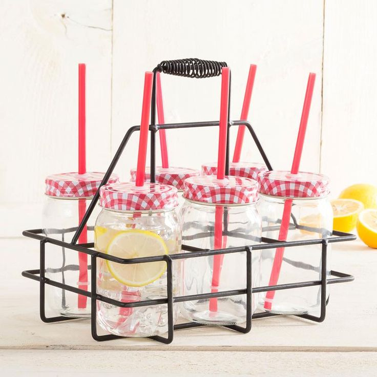 Carry your new Nantucket Mason Jars wherever you neet to take them with the Mason Jar Drink Caddy. The glass nantucket mason jars are a fun and stylish drinking glass and the handy metal carrier is a great way to serve drinks at a backyard BBQ or at the cottage.