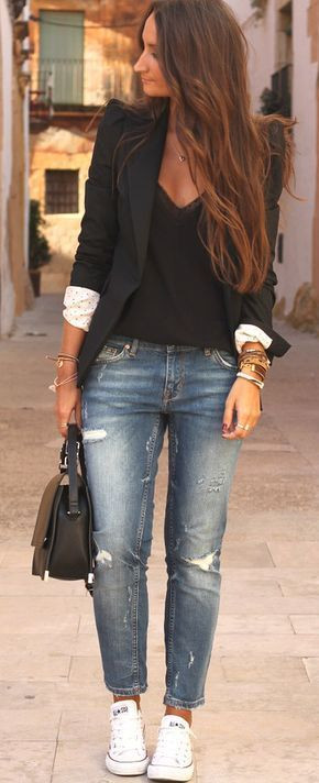 Black blazer over a black blouse with distressed boyfriend jeans and white conve…