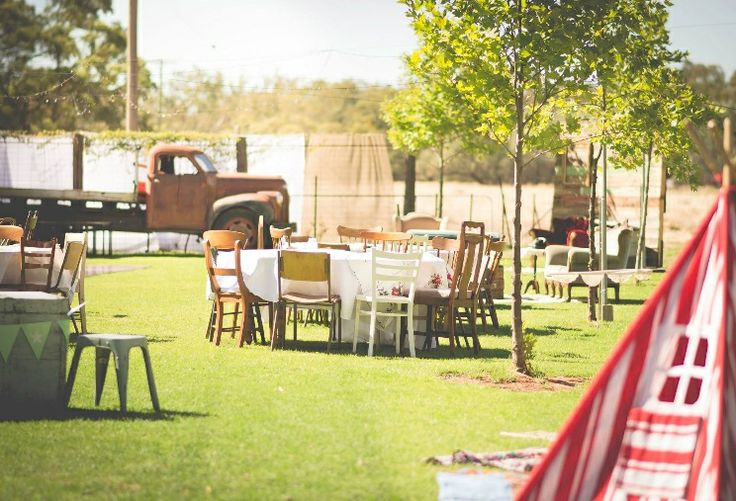 Our Vintage country wedding. Reception area complete with vintage truck,lace table cloths tee-pee for the kids and missed matched chairs