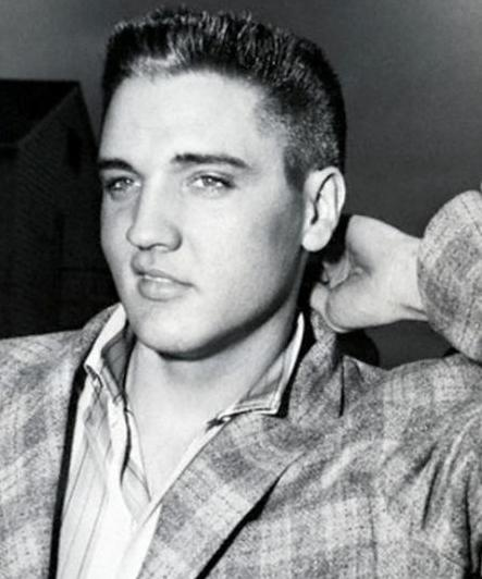 Elvis Presley after getting his official army haircut.