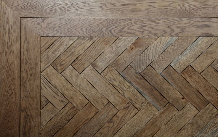 A herringbone design parquet floor - here shown with a double border Material: Oak, stained and oiled