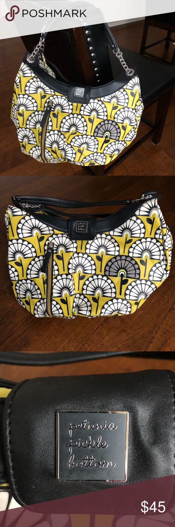 Petunia Pickle Bottom Diaper Bag Petunia Pickle Bottom Hobo style diaper bag! Colors: yellow, black, white, & gray. Used twice, like new! Exterior front has one zipper pocket, interior has 4 slip in pockets, 2 bottle pockets, and diaper changing pad. Snap closure in front. Exterior material can easily be wiped clean. Super cute! Petunia Pickle Bottom Bags Baby Bags