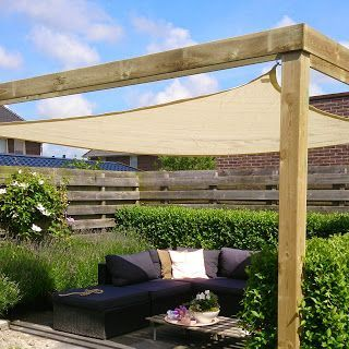 Shade Sail Patio With Modern Furniture And Hedges
