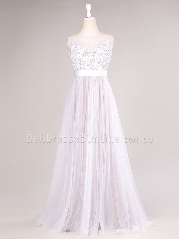 Modern romance is found in this vintage inspired tulle debutante gown. This A-line design featuring an elaborate lace bodice accented with plain grosgrain belt. Complete with illusion bateau neckline and pearl button closure. #lowbackdebdress #seethroughbackdebdress #debutantegown #debdressesonline  #debdresses  #debdressshop  #debutante #debutantes2016  #debutanteball #debdressesmelbourne #chicdebdress
