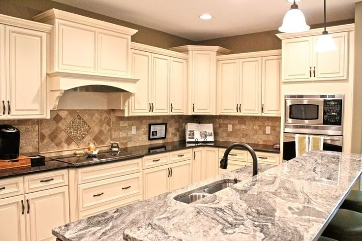 Fabuwood cabinetry wellington ivory finish wellington for Antique ivory kitchen cabinets