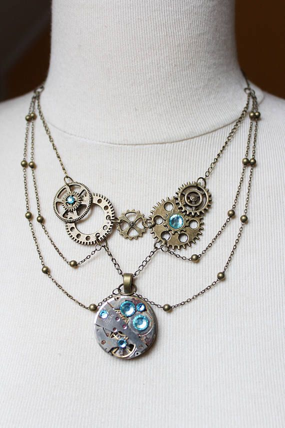 Unique handmade steampunk necklace elegant with bronze gears and light blue rhinestones