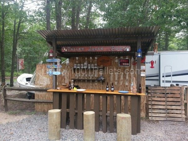 Tiki bar on campsite I have on the Jersey Shore near Long Beach Island. Took 1 day to construct with 8 pallets and a few pieces of store bought lumber. Pal