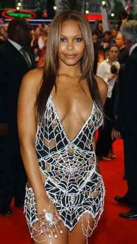 $ 13 million. Singer Samantha Mumba dazzled Spider-Man II London premiere goers in diamond studded dress. The glittering creation by designer Scott Henshall is heading straight for the record books as the most expensive dress yet made.