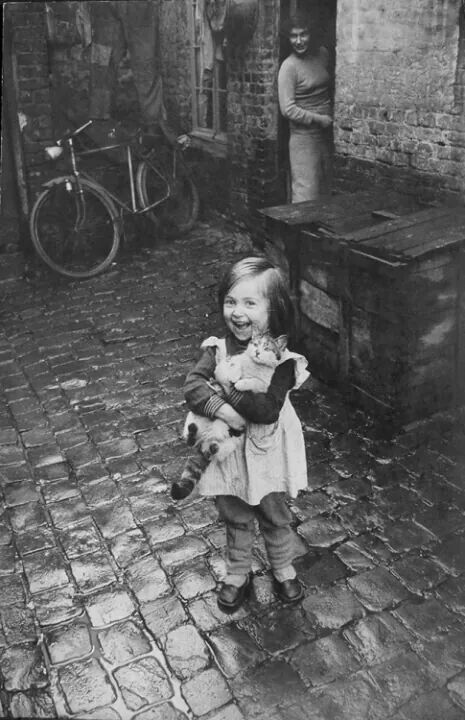 Little girl and her cat in France 1935