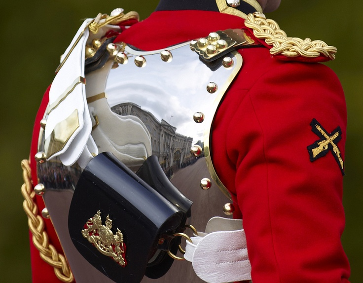 Buckingham Palace - or you can capture the palace indirectly. Here, reflected via the polished breastplate of a Life Guard. Life Guards share duties with the Blues & Royals; together they form the Household Cavalry.  Queen's Life Guard - by Bernie Condon on 500px.