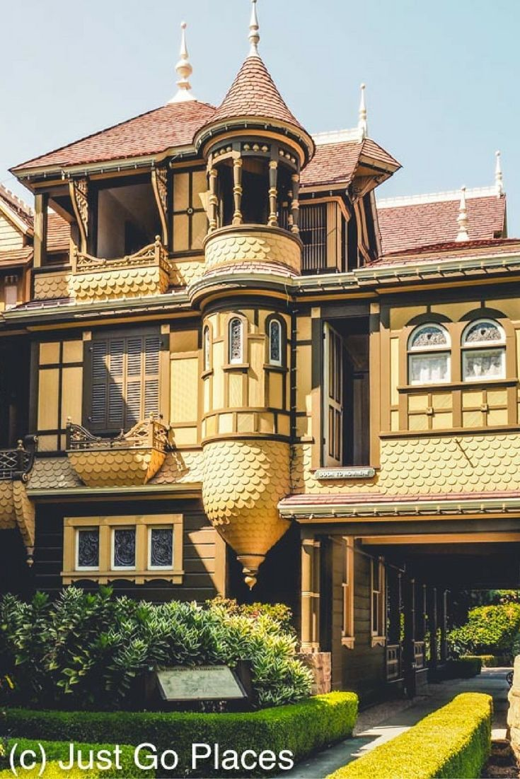 The Winchester Mystery House in San Jose, California.  One of the famous doors to nowhere is on the front side of the house.  Go through the door from the inside of the house and you land one floor below in the front garden.