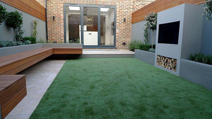 small garden design hardwood floating bench artificial grass outside fireplace BBQ limestone cream paving landscaping clapham chelsea fulham balham battersea dulwich london