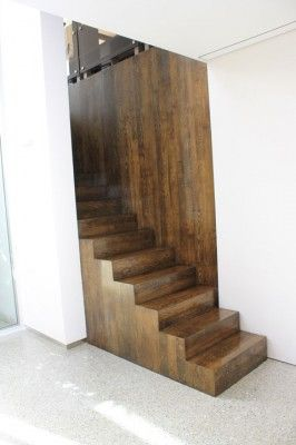 Waterfall Staircase in Stained French Oak.