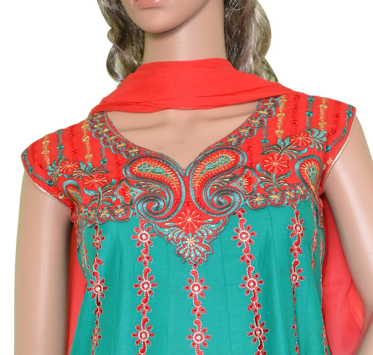 Red and Green Anarkali style Cotton Salwar Kameez with Embroidery lace patch. Additional cloth for optional medium size sleeves available. Match it with simple Gold Jewellery to wear on an Celebratory Occasions. Buy it on www.folklor.in