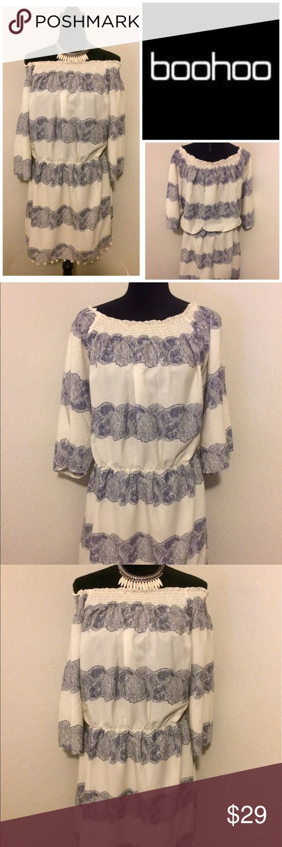 "NWT Boohoo Navy Cream Tunic Dress For sale: NWT navy blue and cream/white Boohoo boho chic off the shoulder pom pom dress/tunic. Elastic at the neckline and waist for stretch and comfort. Pom pom details at the hem. Waist: approximately 40 (unstretched). Pit to pit: approximately 25"". Length: approximately 34"". Note: 1/8 snag at the bottom.  Barely recognizable. See last picture. Can be worn as a dress or tunic depending on style and comfortability. Interested? Like, share, bundle, buy…"