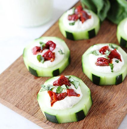 Cucumber canapés with whipped feta, sun-dried tomato and basil | HellaWella #holidayfood #appetizers #partyfood