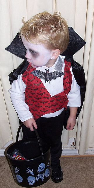 Cute toddler in a vampire costume