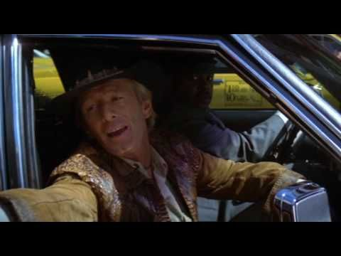 CROCODILE DUNDEE  (1986) with Paul Hogan and Linda Kozlowski. An American reporter gos to the Australian outback to meet an eccentric crocodile poacher and invites him to New York City.