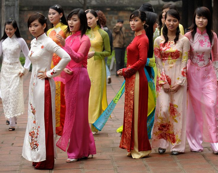 Vietnamese girls in colorful ao dai, a traditional outfit associated with Vietnam.