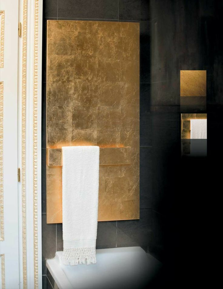 SMOOTH PRESTIGE design ridea Precious metals, clean silhouettes, smooth plates, reflective walls: the light is amplified to improve the furnishing and the luxurious and precious space. #home #interiordesign #ridea #design #radiator #fornitire #bath