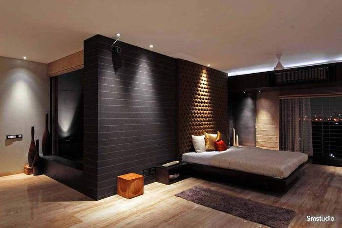 Dark walls with yellow spot lights enriches the regal look of this bedroom #bedroom #homedecor #black #contemporary Design Courtesy - smstudio, Mumbai