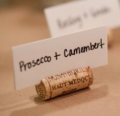 DIY Wine Cork Place Card Holders - great use for all those wine corks you've been saving.  Use to label wine and food pairings at a tasting party or dishes on a buffet.
