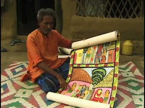 For generations, Patua (Chitrakar) communities of West Bengal, India have been painters and singers of stories depicted in scrolls. The Patuas tell the stories of Muslim saints (pirs and fakirs) as well as Hindu Gods and Goddesses, and offer devotion to saints at Muslim shrines. In the past they used to wander from village to village, receiving rice, vegetables and coins for their recital. They would unroll a scroll, a frame at a time, and sing their own compositions. But competition from…