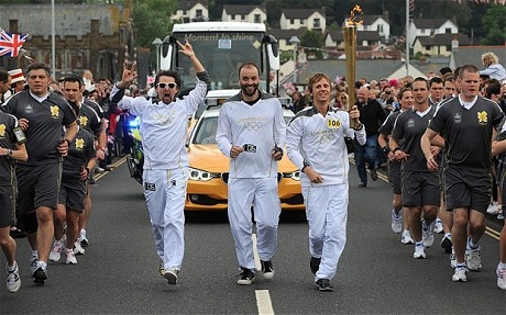 MUSE carrying the Olympic Torch at Teignmouth - 2012