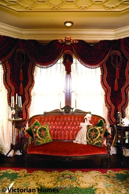 red velvet drapery swags & long matching Lambriquins trimmed with pompom fringe (Victorian parlor)