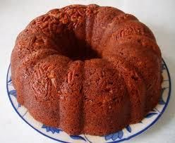 Bahama Mama Banana Rum Cake from Food.com: A cake that blends a favorite drink with a rum cake and pound cake. This is dense, but not heavy, and the spicy molasses kick from the dark rum enhances the banana flavor. You may use light or dark brown sugar.