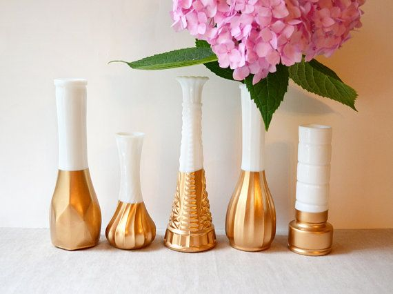 I could only do this with broken pieces. I'm  a milk glass purist. But it's cool: Gold Dipped Milk Glass Vase - Set of 5 vases - vintage wedding on Etsy, $47.50