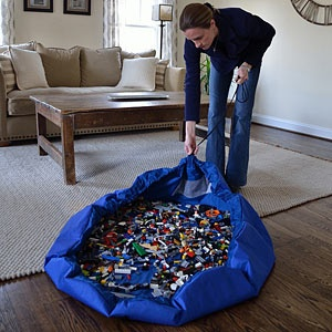 Lay-n-Go Construction set carrier...Lay-N-Go lets your LEGO builder bring their collection anywhere in the house and clean it up in less than a minute. Sounds too good to be true? It's not! Lay-N-Go is an activity mat that converts into a storage bag, making moving your LEGO collection from room to room effortless. When playtime is over, pull the drawstring and the bag will seal up securely, keeping even the smallest of pieces inside.