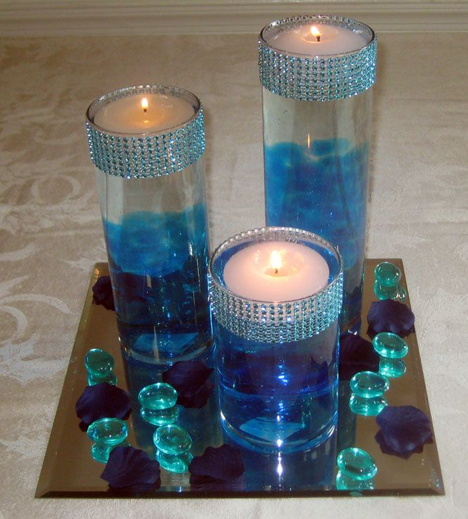 Three cylinder centerpiece for a peacock theme  - See more vow renewal ideas at IDoStill.com