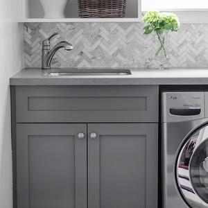 Well Nested Interiors - laundry/mud rooms - laundry room, laundry room backsplash, herringbone tiles, calcutta marble herringbone tiles, calcutta marble herringbone backsplash, cabinets,