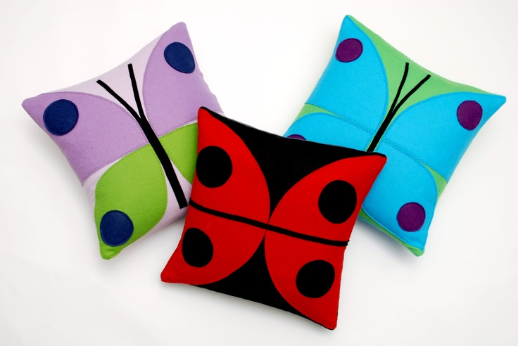 The Nugget Ladybird and Butterfly cushions look fun together.