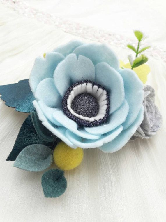 A beautiful, soft and so bright spring flower headband for you or your little one.  Each headband includes one large baby blue anemone with glittered ball center, heathered grey rose and a lemon yellow bush, among the emerald greens, decorated with amazing teal faux leather leaves, floral bud and artificial twigs. The arrangement arrives on a nylon band. The special feature of this nylon band is that it is extremely soft, stretchy, non-marking; it does not leave a dent. The band will stretch…