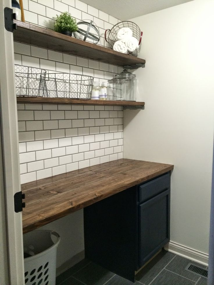 Folding station - great rustic farmhouse laundry room table and shelf idea