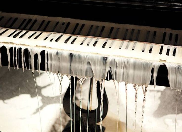 "Tatiana Blass, ""Half of the speech on the ground - Deaf Piano"", 2010. As a pianist plays pieces by Frédéric Chopin, men melt wax on the instrument. As the wax cools and dries, sound emission is gradually extinguished."
