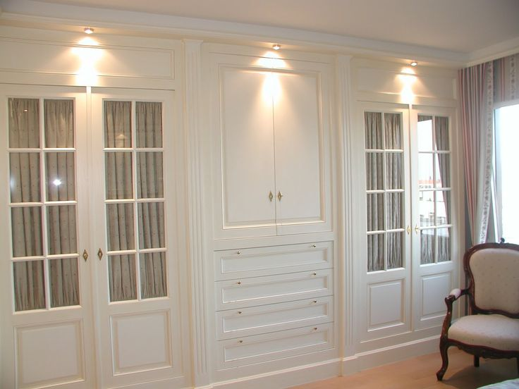 """Like theirs of placing fabric behind the glass! Breaks up the """"too much white"""" door look that built ins have."""