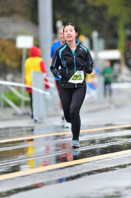 """Li Haitian completing the  Zurich Marathon in her VIVOBAREFOOT Evos    """"It was great training and running the race in them, no joint pain at all even at the end of marathon."""""""