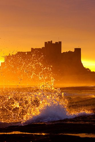 Sunrise at Bamburgh Castle on the Northumberland coast.