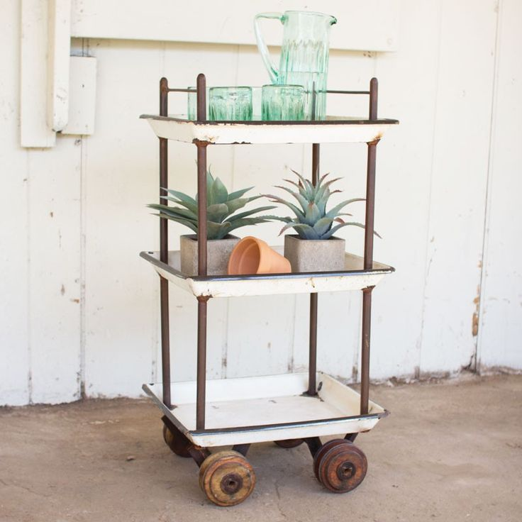 So your garden needs some tending to. And you need a big pitcher of water to keep hydrated. Load your supplies on this chic bar cart to get your work done. And when you're finished? Dust it off and pile the drinks on it for a festive affair that evening with friends//