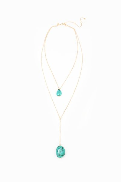 The easiest way to layer necklaces is when the work is done for you. Voila! $32