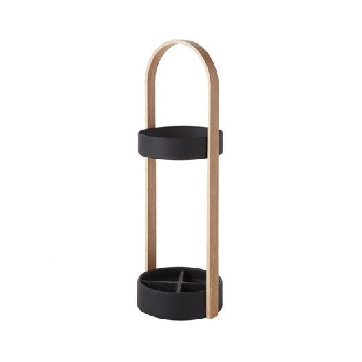 Umbra Hub Umbrella Stand - next to leather ottomans