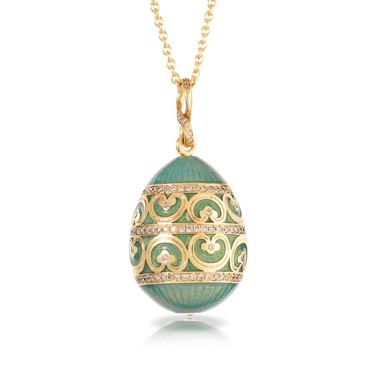 Oeuf Yusupov Empereur Bleu du Nil. The egg is crafted in yellow gold, evoking the lavish gilt interiors of this vast palace, skillfully guilloché engraved, in time-honoured Fabergé tradition, and ornamented with a finely chased gold ornamental frieze in rococo mood, all highlighted with white diamonds.This piece is set in 18 carat yellow gold and features white round diamonds. The egg is 22mm in height.   $12,411.00 US