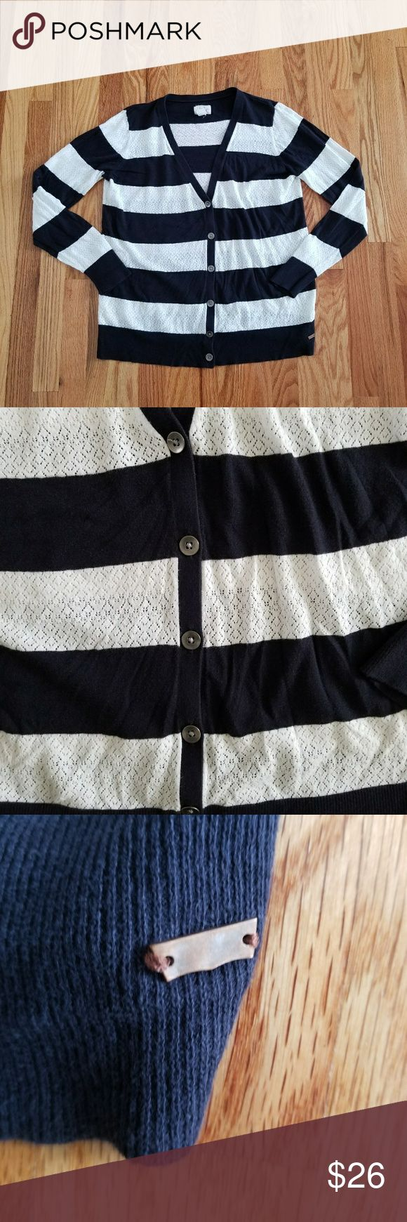 Levis Nautical Knit Cardigan This fine knitted cardigan makes for a comfortable and delicate look. The buttons are made of metal as well as the Batwing logo sewn in on the side. It's great nautical wear for the summer time goes great with white shirts or jeans! Size Large. Levi's Sweaters Cardigans